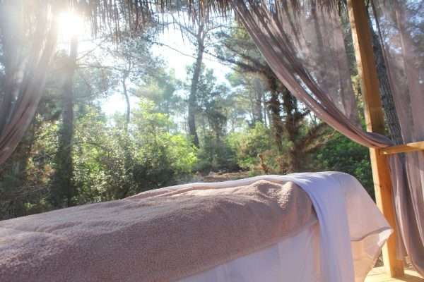 Massage bed on a wooden deck in the forest