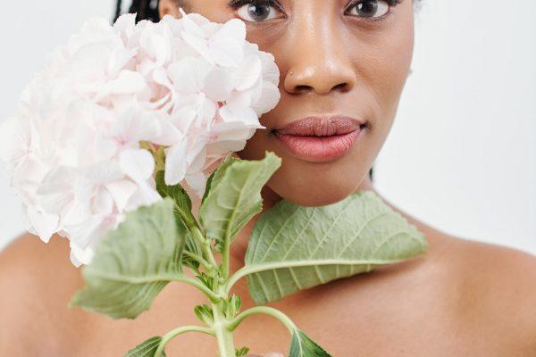Woman posing with hydrangea flower
